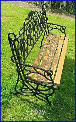 Old vintage ornate Cast Iron Back panel & Ends with Teak Slat Seat Garden Bench